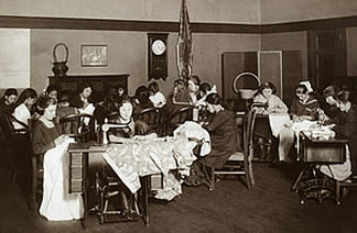 Immigrant women learning to sew